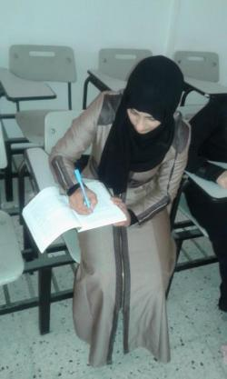 Nadia at a desk at her university