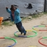 Young girl in Gaza jumps from hoop to hoop during psychosocial activity