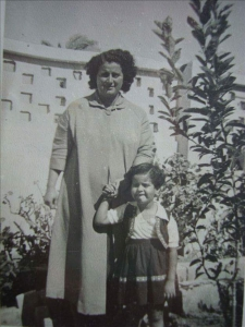 Dr. Mona as a child holding her mother's hand