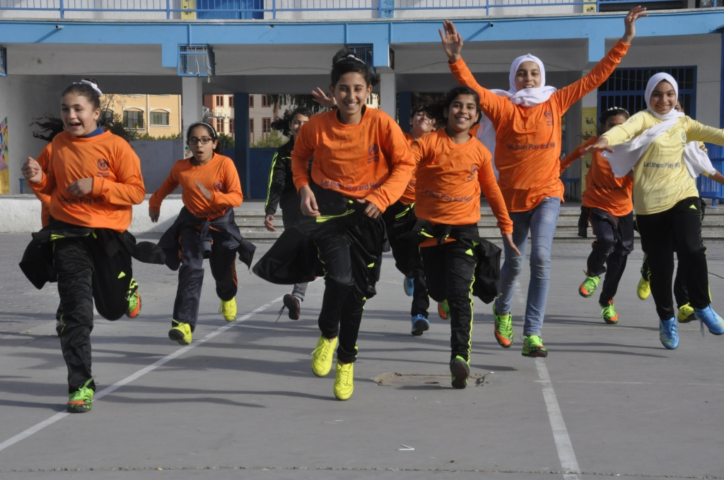 Girls running with joy during sports project