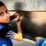 Boy drinking clean water at school in Gaza